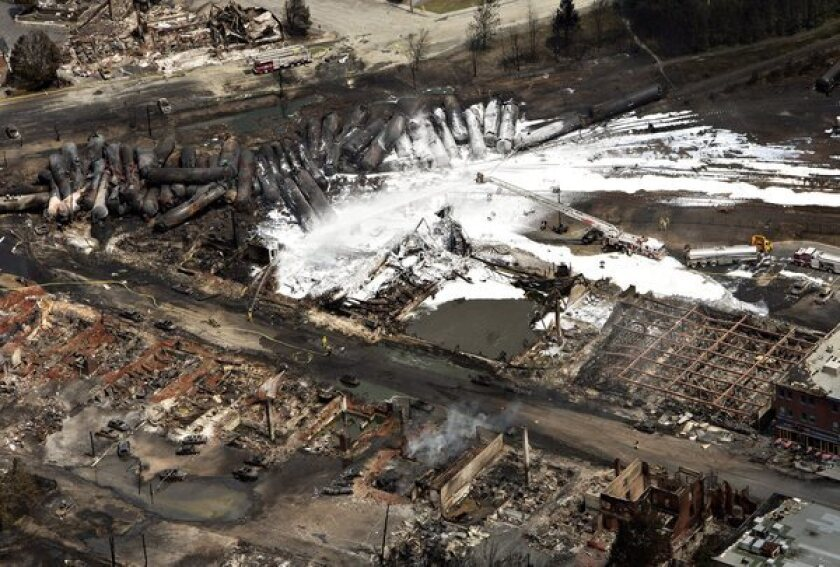 The downtown core of Lac Megantic, in the Canadian province of Quebec, lies in ruin after a runaway train of crude oil tankers derailed and exploded Saturday. The disaster, the deadliest rail accident in Canada in more than a century, has intensified the debate over whether rail or pipeline transport of oil is safer.