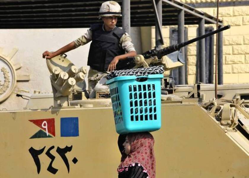 An Egyptian soldier stands guard at the Tora prison in Cairo. Over the last two months, security forces have ousted and jailed Egypt's first freely elected president, killed or imprisoned hundreds of his Muslim Brotherhood supporters, and reasserted the pillars of Hosni Mubarak's police state.