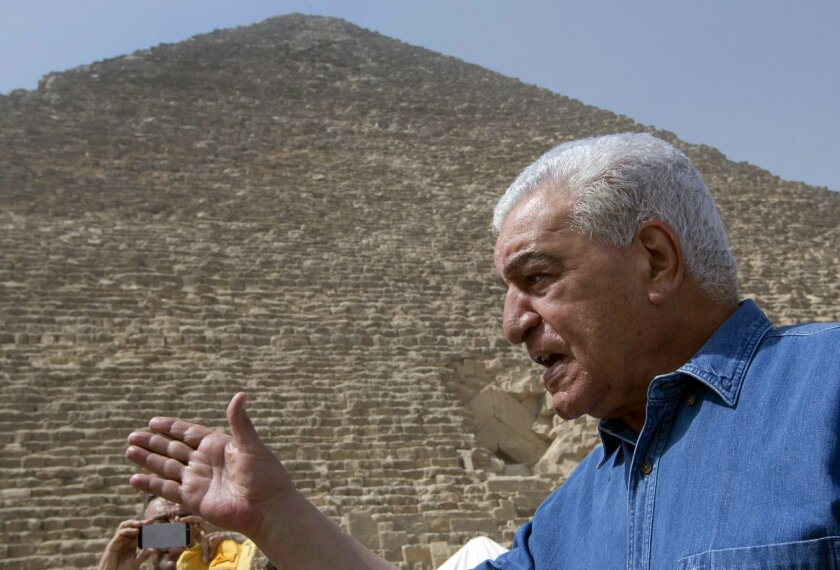 Egyptian archaeologist Zahi Hawass, Egypt's former head of antiquities, speaks in front of the Great pyramid, built by Cheops, known locally as Khufu in Giza, Egypt, Thursday, June 2, 2016. A scientific team scanning the Great Pyramid aimed at discovering the famed pharaonic monument's secrets incl