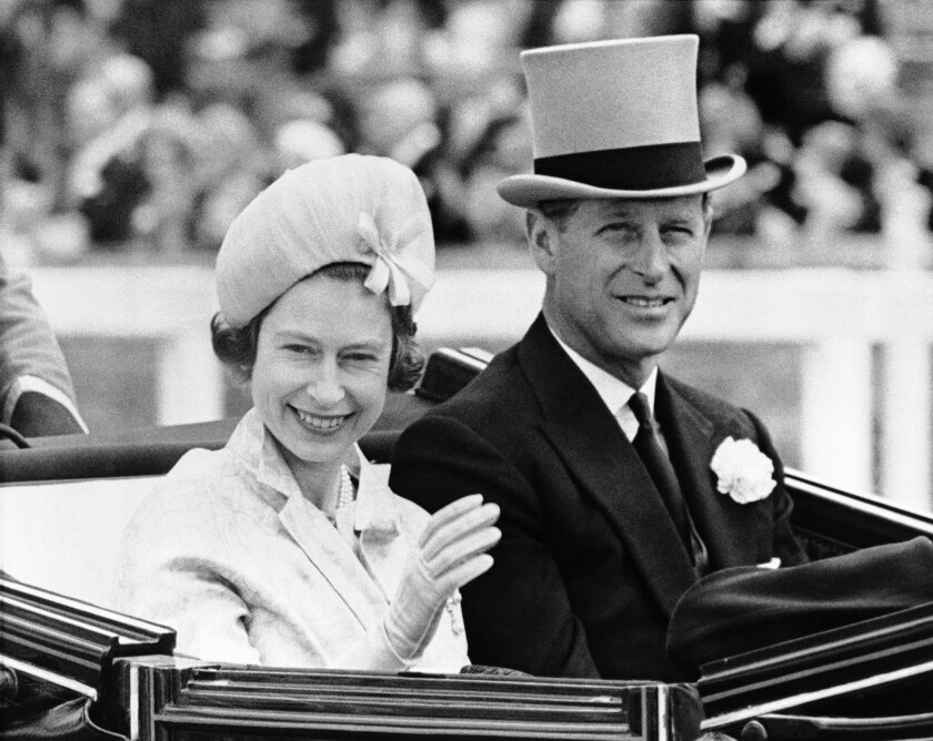 FILE - In this June 19, 1962 file photo, Britain's Prince Philip and his wife Queen Elizabeth II arrive at Royal Ascot race meeting, England. There certainly won't be fuss. Count on that. When Britain's Prince Philip reaches the grand age of 99 on Wednesday, he will spend it quietly and in much the same way he's spent most of his adult life: beside Queen Elizabeth II. (AP Photo/File)