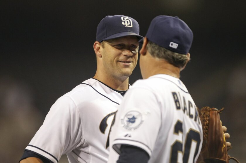 The Padres' starting pitcher Eric Stults, left, is congratulated by Padres manager Bud Black after he and the Padres beat the Rockies 2-1.