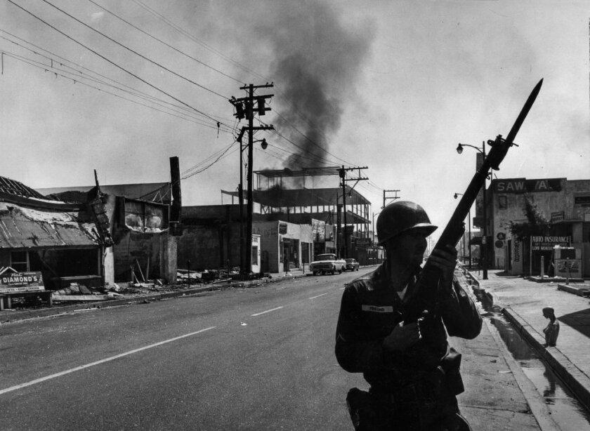 A California National Guardsman patrols 103rd Street near Compton Avenue in Watts' business district.