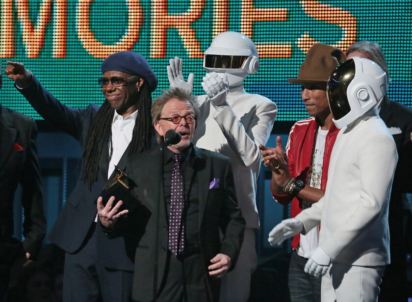 """Paul Williams accepts the Grammy and speaks after the album of the year win for Daft Punk's """"Random Access Memory"""" on Sunday night. Behind him are Nile Rodgers, left, a Daft Punk member, Pharrell Williams and the second Daft Punk member."""