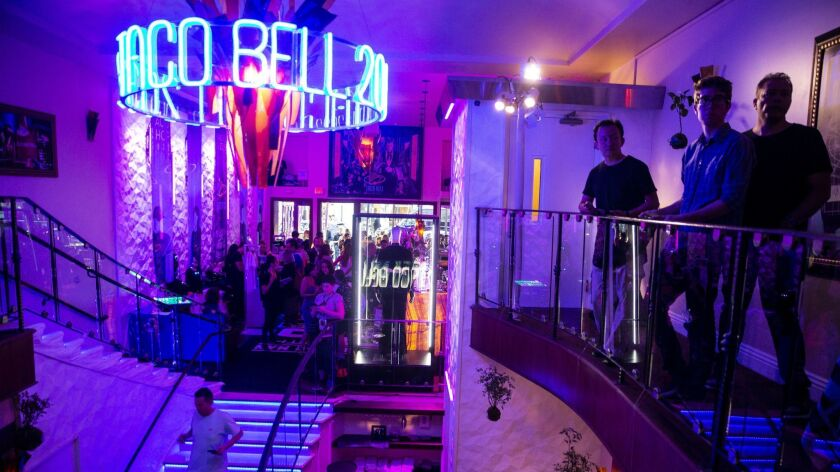 SAN DIEGO, CALIF. - JULY 19: People hang out in the Demolition Man Taco Bell 2023 activation space d
