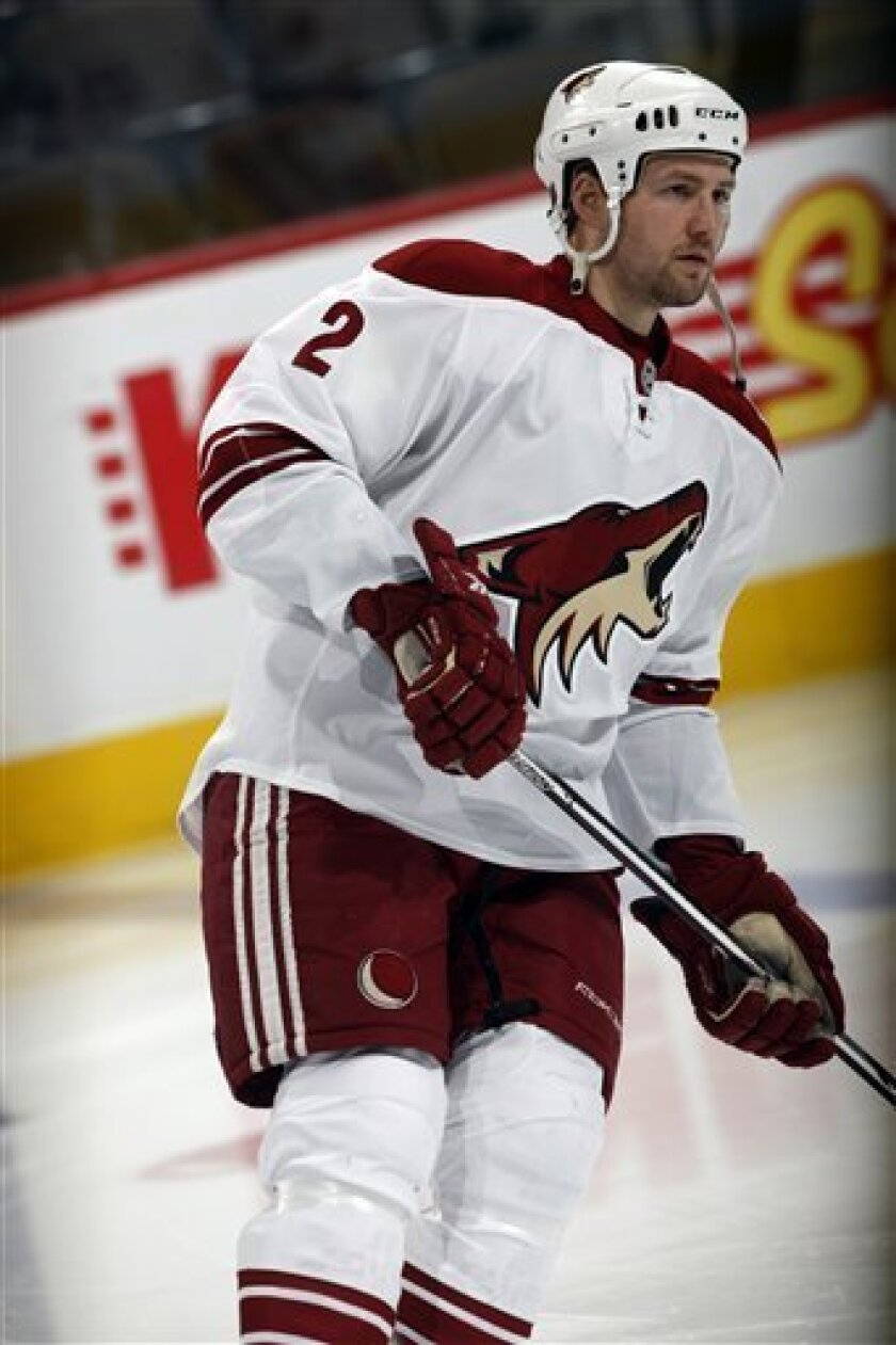 FILE - This Feb. 12, 2010, file photo shows Phoenix Coyotes defenseman James Vandermeer warming up before facing the Colorado Avalanche in the first period of an NHL hockey game in Denver. The Edmonton Oilers have traded forward Patrick O'Sullivan to the Phoenix Coyotes for defenseman Jim Vandermee