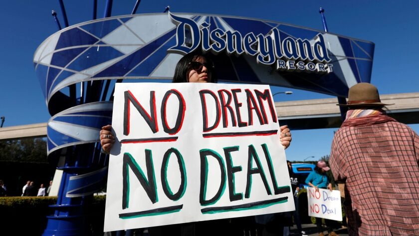 Supporters of the Deferred Action for Childhood Arrivals program rally at an entrance to the Disneyland Resort in Anaheim on Jan. 22.