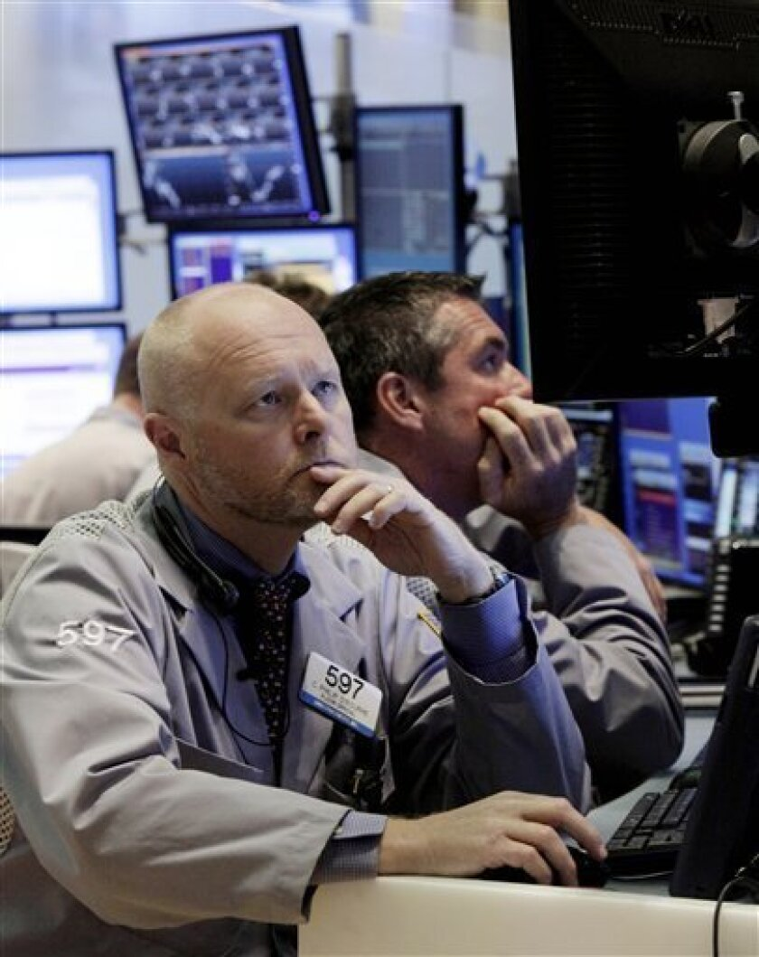 Trader Philip O'Rourke, left, works on the floor of the New York Stock Exchange Monday, June 7, 2010. (AP Photo/Richard Drew)