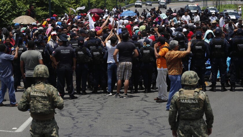 Mexican authorities stop a migrant caravan that had earlier crossed the Mexico - Guatemala border, n