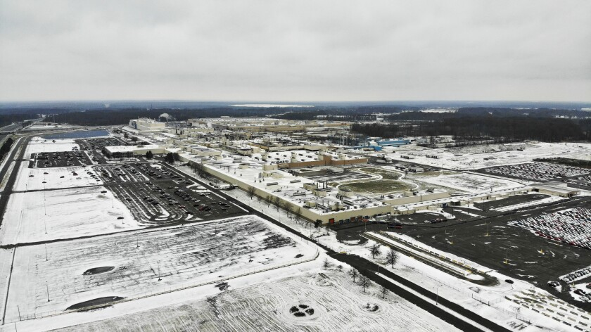 FILE - In this Nov. 28, 2018, file photo, snow covers the perimeter of the General Motors' Lordstown plant, in Lordstown, Ohio. The Trump administration's budget proposal scraps a loan program that could help an upstart electric vehicle company's plans to reuse the now-closed General Motors factory in Lordstown, Ohio. (AP Photo/John Minchillo, File)