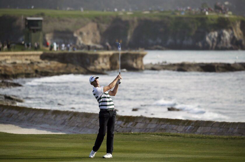 Vaughn Taylor chips the ball up to the 18th green of the Pebble Beach Golf Links during the final round of the AT&T Pebble Beach National Pro-Am golf tournament Sunday, Feb. 14, 2016, in Pebble Beach, Calif. Taylor won the tournament. (AP Photo/Eric Risberg)