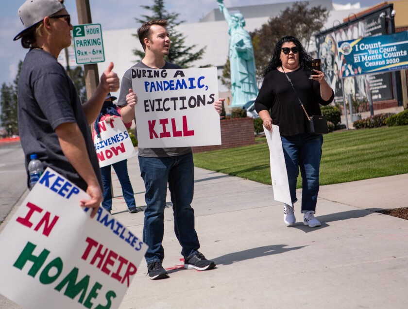 Ian Jameson, center, of El Monte leads a group of tenant rights activists outside El Monte City Hall in March.