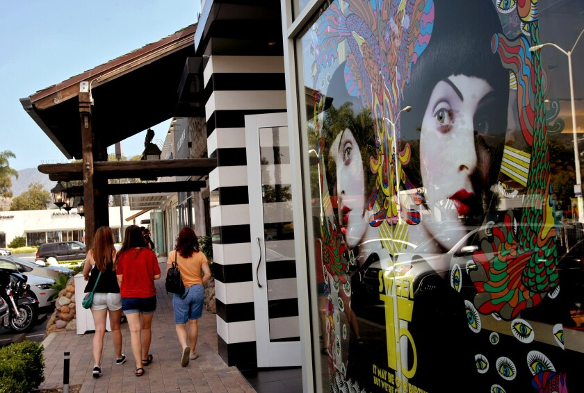 Shoppers walk past Sephora, a chain of perfume and cosmetic stores, at the Malibu Village.