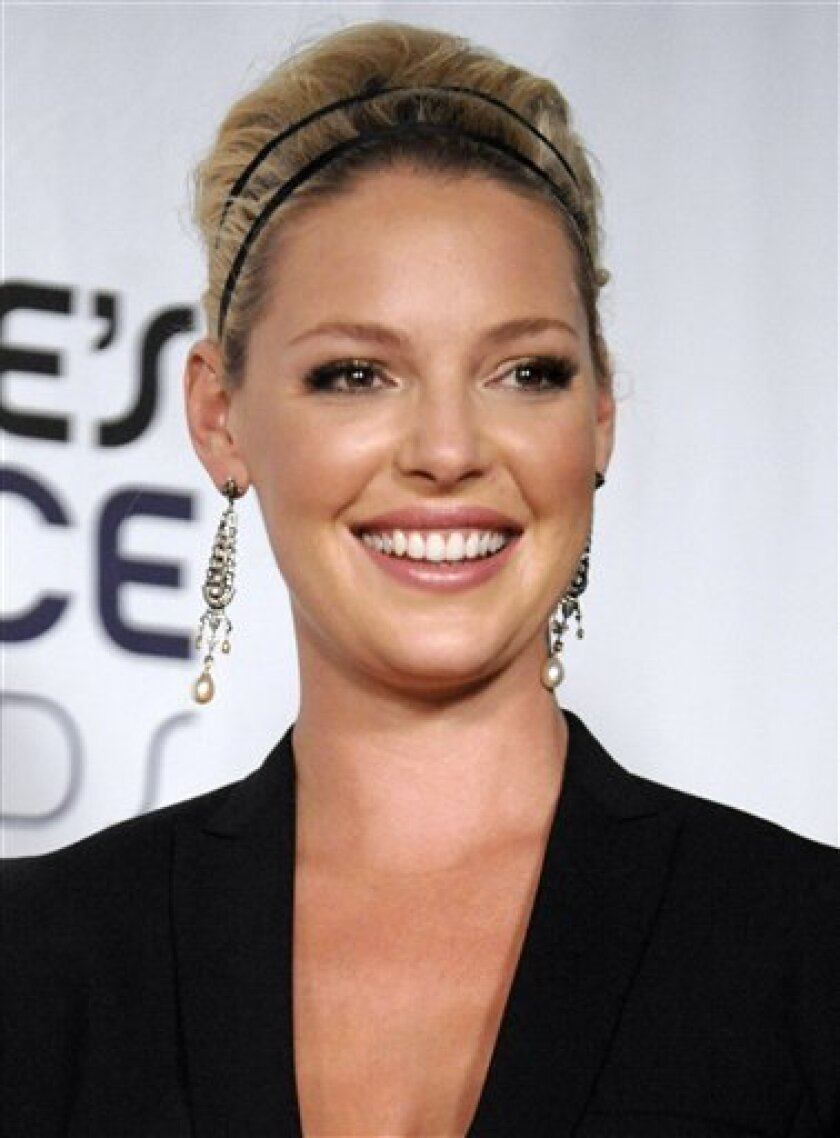 """In this Jan. 7, 2009 file photo, Katherine Heigl poses backstage at the 35th Annual People's Choice Awards in Los Angeles. Heigle plays Dr. Isobel Stevens in the television series """"Grey's Anatomy."""" (AP Photo/Chris Pizzello, file)"""