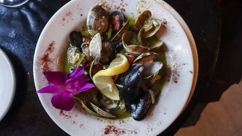At the popular Fountain Cafe, diners enjoy local specialties such as clams and mussels in a basil-Chardonnay broth.