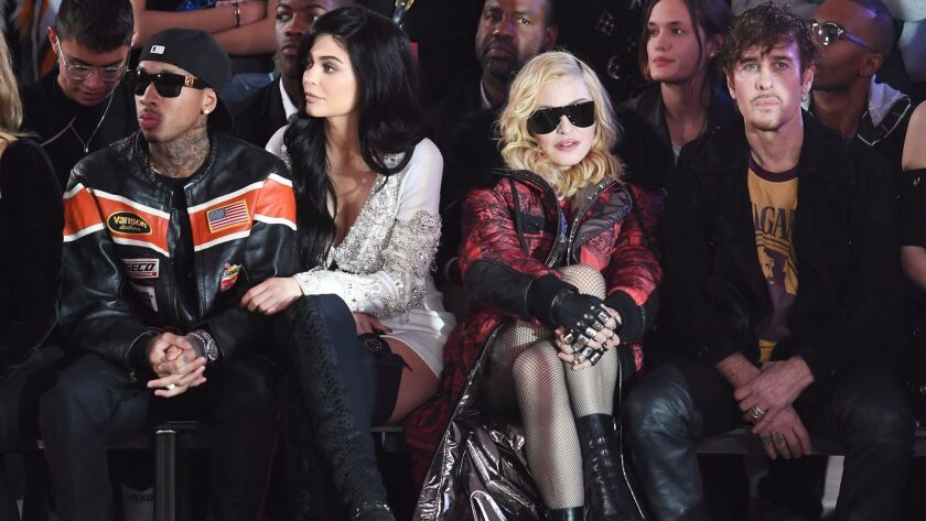 Tyga, from left, Kylie Jenner, Madonna and Steven Klein sit front row at the Philipp Plein runway show.