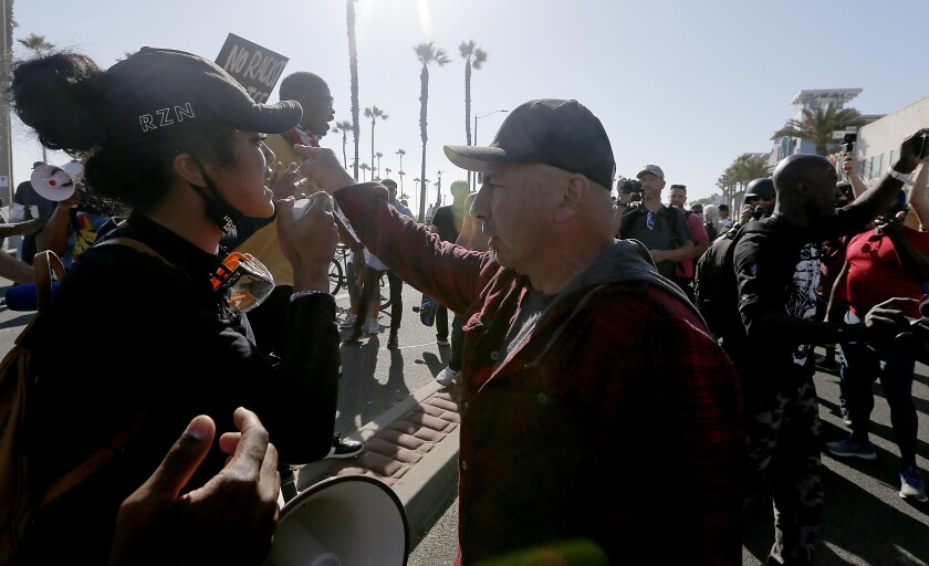 Tempers flare between Black Lives Matter demonstrators and Trump backers in O.C.