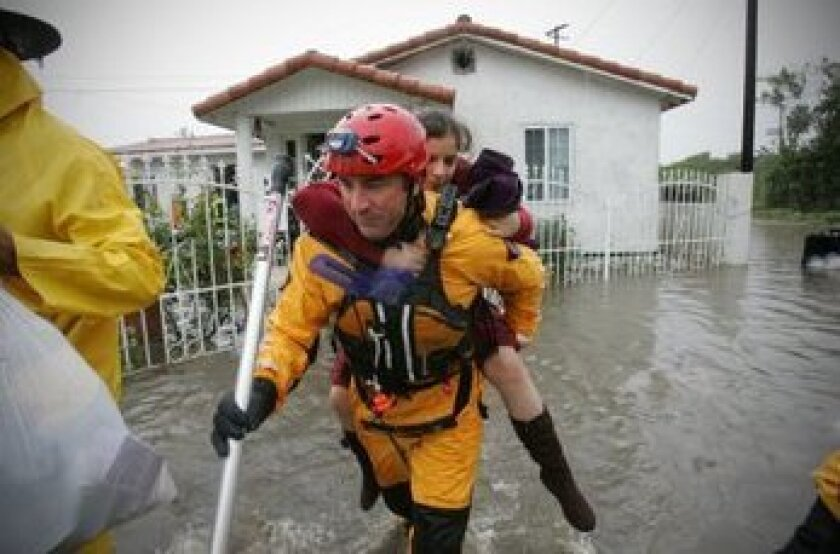 Last December, lifeguard John Bahl carried Diana Rivera from her home on Yama Street in San Diego.