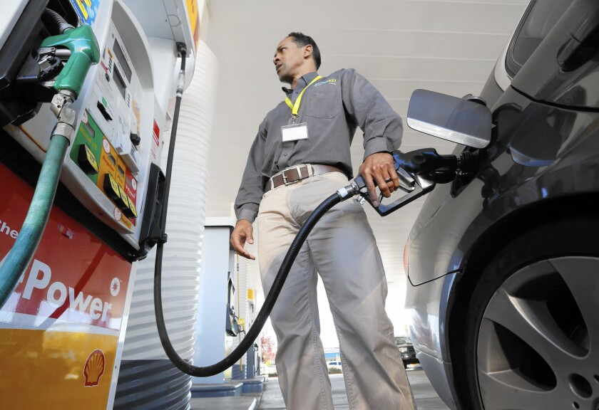 California's 30-cent-a-gallon excise tax on gasoline will drop to 27.8 cents July 1 as a result of a 3-2 vote by the state Board of Equalization. Above, Eric Henry buys gas in Sacramento in March 2014.