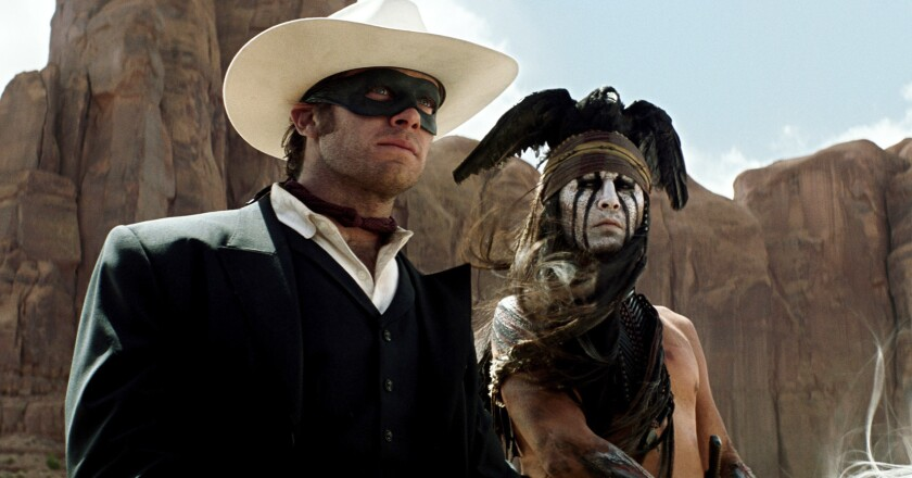 """Armie Hammer, left, stars as the titular hero and Johnny Depp as Tonto in """"The Lone Ranger."""""""