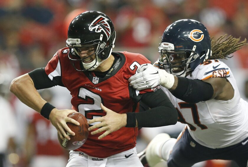 Atlanta Falcons quarterback Matt Ryan (2) is sacked by Chicago Bears defensive end Willie Young (97) during the second half of an NFL football game, Sunday, Oct. 12, 2014, in Atlanta. The Chicago Bears won 27-13. (AP Photo/Brynn Anderson)