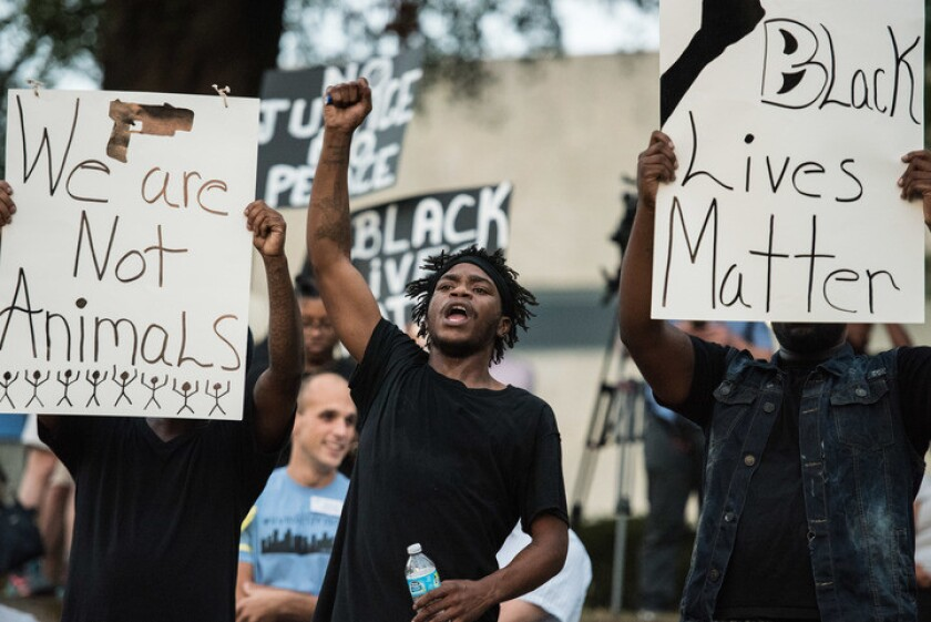 Demonstrators protest in Marshall Park in Charlotte, N.C.