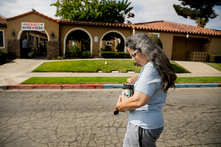 Dee Massey walks to the Arroyo Vista Nursing Center in City Heights