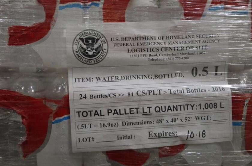 Detalle de un lote de botellas de agua guardadas en un almacen. EFE/Archivo