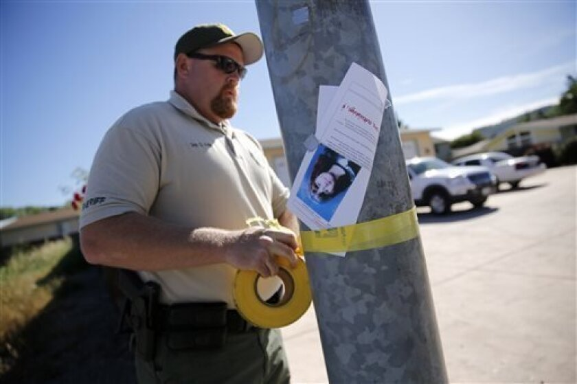 Lake County Sheriff's Deputy G. Wells tapes off an area around a house on Highlands Harbor Drive during the search for missing 9-year-old autistic girl Mikaela Renee Lynch on Monday, May 13, 2013 in Clearlake, Calif. A dive team found Mikaela's body in a muddy creek. The phenomenon of bolting affects large numbers of children with autism, researchers say. And the deaths - 60 in the past four years - are prompting new efforts to raise awareness and find more effective preventive measures. (AP Pho