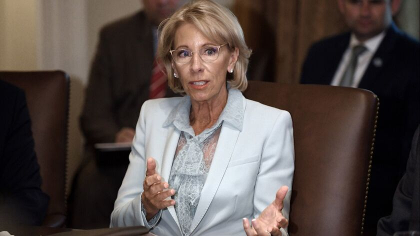 Coronavirus: Betsy DeVos downplays school opening risk - Los ...