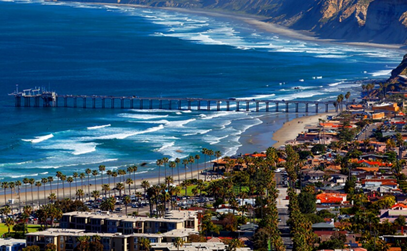 Real estate with coastal views and close proximity to beaches is especially coveted in Southern California. Pictured is one of the area landmarks, Ellen Browning Scripps Memorial Pier in La Jolla. As one of the world's biggest research piers, Scripps Pier is used for boat launching and a variety of experiments conducted by Scripps Institution of Oceanography.