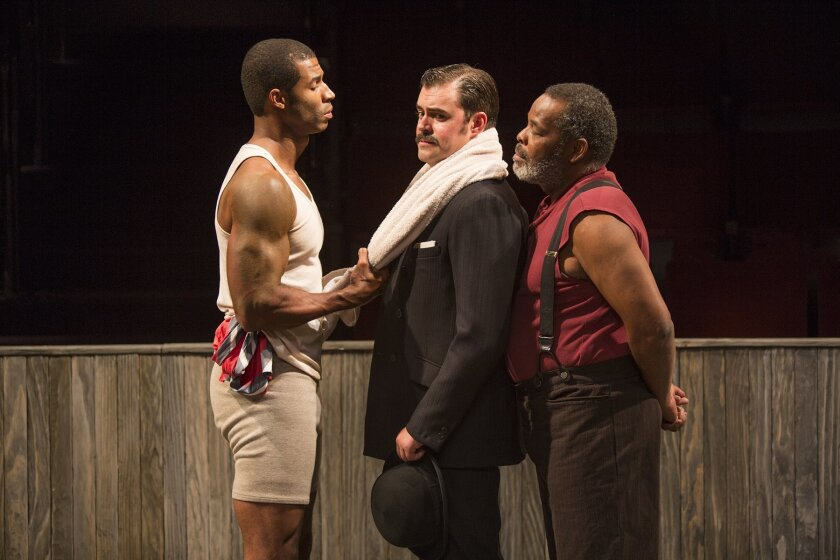 Jay (Robert Christopher Riley) asks key questions of his trainer Max (John Lavelle) as Wynton (Ray Anthony Thomas) looks on in The Old Globe's 'The Royale,' directed by Rachel Chavkin.