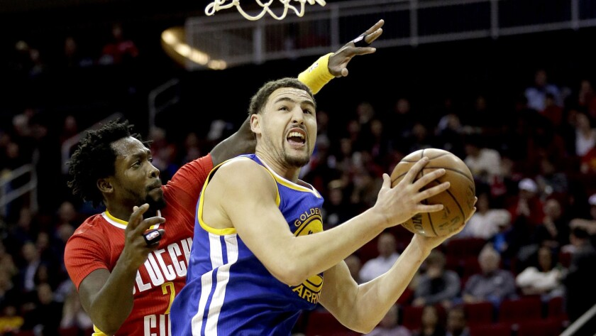 Warriors guard Klay Thompson has hit shot challenged by Rockets guard Patrick Beverly during the first half Thursday night.