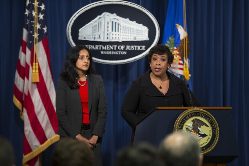 Vanita Gupta, left, head of the Justice Department's civil rights division, with Atty. Gen. Loretta Lynch.