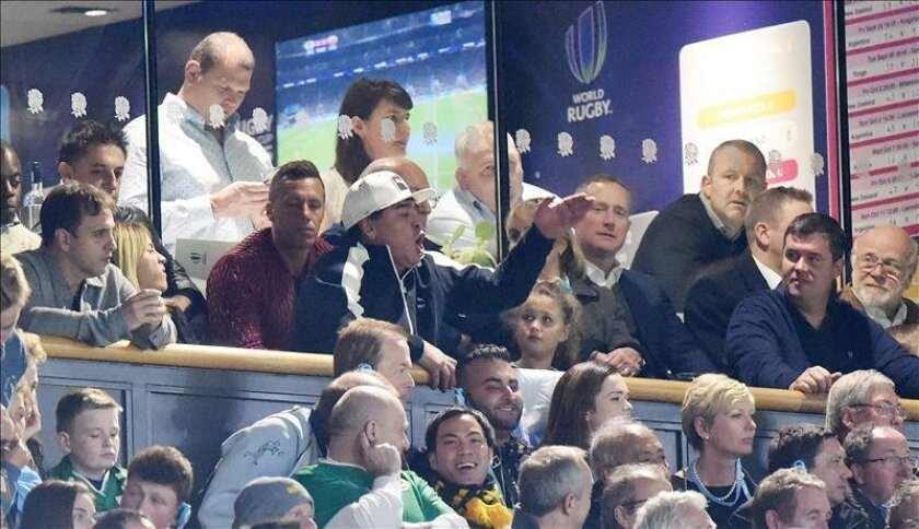 Former Argentina soccer legend Diego Maradona (C) cheers during the Rugby World Cup 2015 semi final match between Argentina and Australia at Twickenham stadium in London, Britain, October 25, 2015. EFE/FACUNDO ARRIZABALAGA