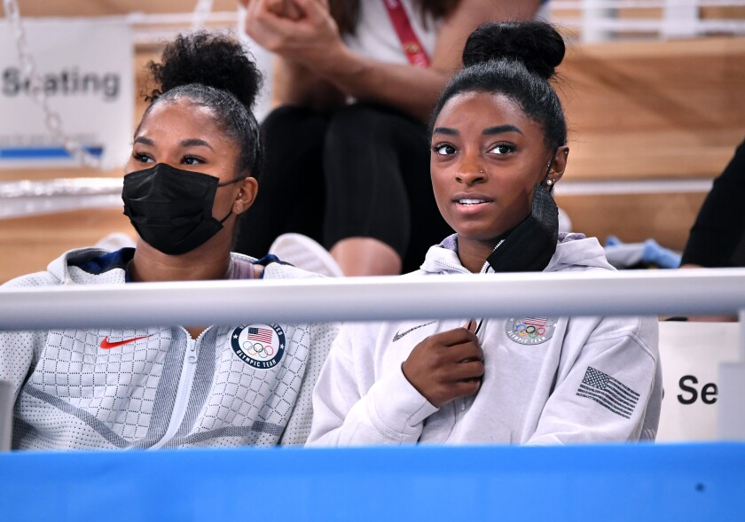 U.S. gymnasts Simone Biles, right. and Jordan Chiles watch the women's individual all-around final at the Tokyo Olympics.