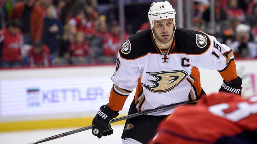Ducks center Ryan Getzlaf, shown in a game in December, shouts at assistant coach Trent Yawney during practice.