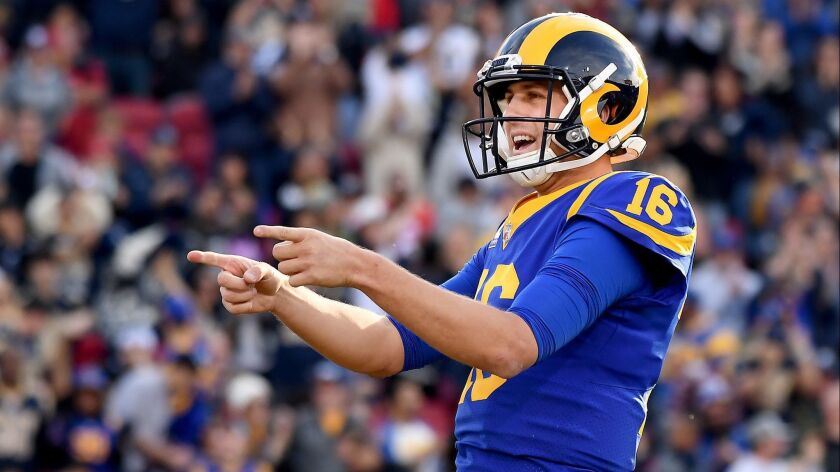 Rams quarterback Jared Goff celebrates his touchdown pass to Brandin Cooks against the 49ers in the second quarter at the Coliseum during their Week 17 game.