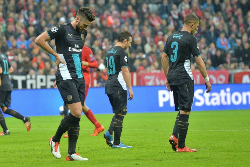 Arsenal's players leave the pitch after their Champions League Group F soccer match between Bayern Munich and Arsenal FC in Munich, southern Germany, Wednesday, Nov. 4, 2015. Munich won 5-1. (AP Photo/Kerstin Joensson)