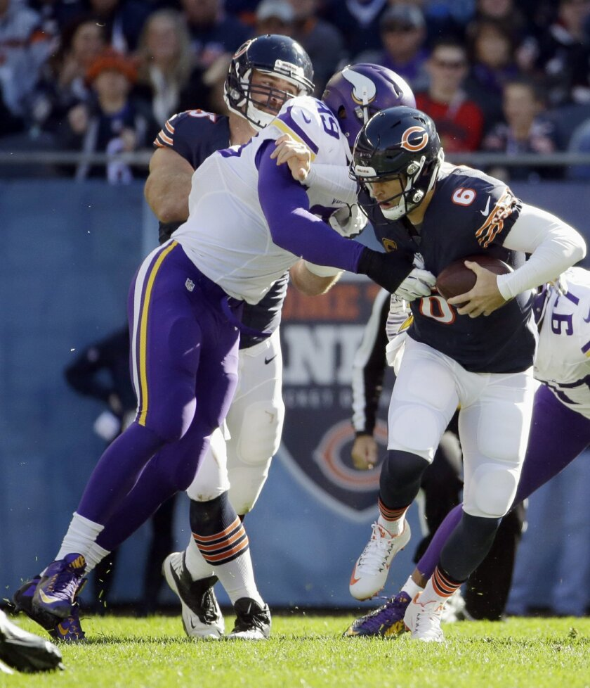 Minnesota Vikings defensive end Danielle Hunter (99) tackles Chicago Bears quarterback Jay Cutler (6) during the first half of an NFL football game, Sunday, Nov. 1, 2015, in Chicago. (AP Photo/Nam Y. Huh)