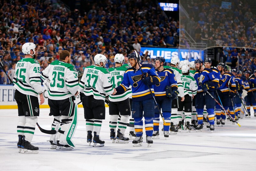 Players on the Dallas Stars and St. Louis Blues take part in the traditional post-playoff series handshake following the Blues' win in Game 7 of the Western Conference semifinals in May 2019.