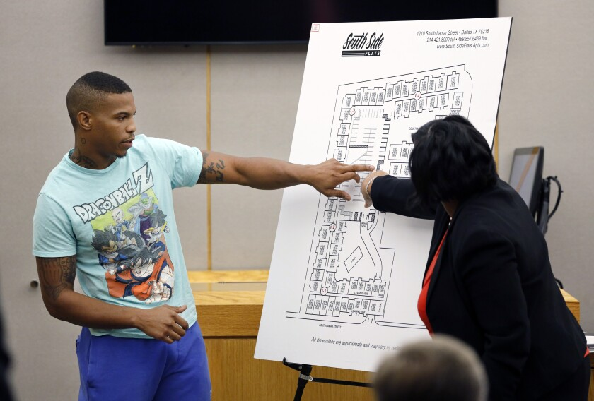 FILE - In this Sept. 24, 2019, file photo, victim Botham Jean's neighbor Joshua Brown, left, answers questions from Assistant District Attorney LaQuita Long while testifying during the murder trial of former Dallas Police Officer Amber Guyger, in Dallas. Authorities have indicted three men for capital in a shooting that killed Brown. (Tom Fox/The Dallas Morning News via AP, Pool)