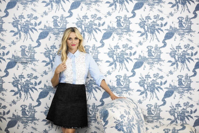 Reese Witherspoon in her own clothing line Draper James. She is wearing the Lucy Embellished Lace Button Down Shirt $225.