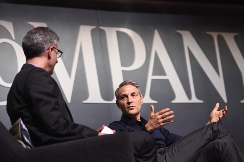 Endeavor Chief Executive Ari Emanuel, right, onstage with the editor-in-chief of Fast Company, Robert Safian, at the Fast Company Innovation Festival in 2015 in New York City. Endeavor said Wednesday that it is laying off as many as 250 people.