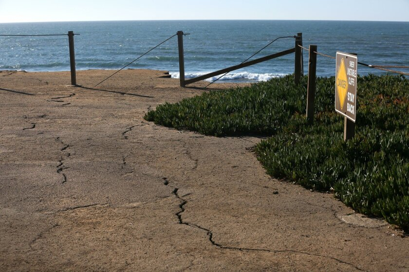 City of San Diego lifeguards blocked off a section of Sunset Cliffs, one of the many turnout parking areas along the bluffs themselves, because it has developed a series of cracks in the asphalt in that parking area.