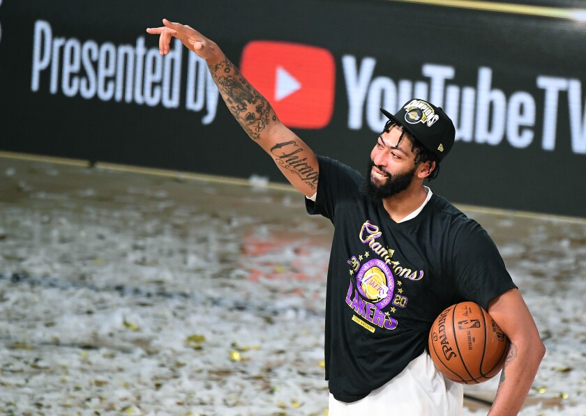 Lakers star Anthony Davis celebrates the NBA championship after winning Game 6 of the Finals on Oct. 11, 2020.