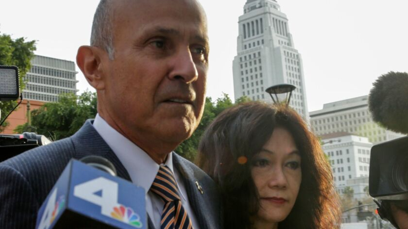 Former L.A. County Sheriff Lee Baca and his wife, Carol Chiang, arrive at federal court in Baca's 2017 obstruction of justice trial. Baca has been ordered to report to prison to begin his sentence by Feb. 5.