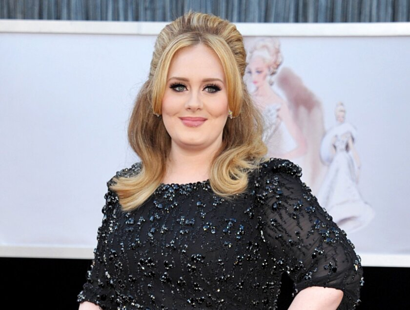 "FILE - In this Feb. 24, 2013 file photo, singer Adele arrives at the Oscars in Los Angeles. Adele's new album ""25"" has sold more than 2.3 million copies in the United States during its first three days on the market, a stunning number for a music industry that has seen sales steadily fall in the digital era. (Photo by John Shearer/Invision/AP, File)"
