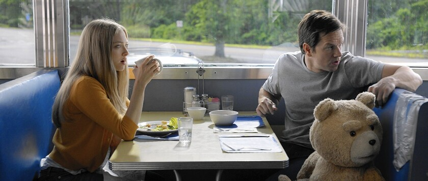 """Amanda Seyfried, left, plays a lawyer helping Mark Wahlberg and his best friend Ted, a potty-mouthed teddy bear, in """"Ted 2."""""""