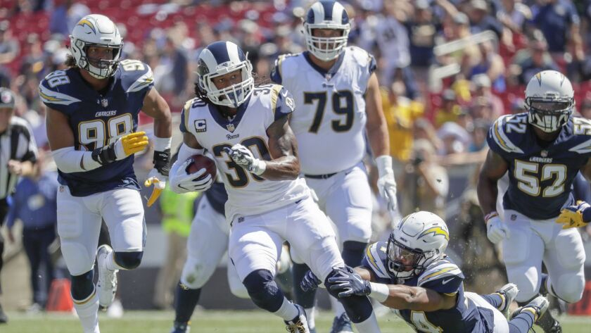 LOS ANGELES, CA, SUNDAY, SEPTEMBER 23, 2018 - Rams running back Todd Gurley breaks the tackle of Cha
