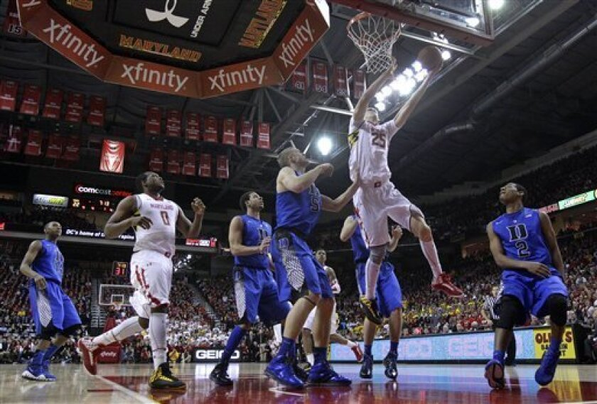 Maryland center Alex Len (25), of Ukraine, goes up for a shot above Duke forward Mason Plumlee (5) and guard Quinn Cook (2) in the first half of an NCAA college basketball game in College Park, Md., Saturday, Feb. 16, 2013. (AP Photo/Patrick Semansky)